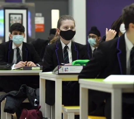 Furious parents are threatening to launch legal action to force ministers to get rid of masks from the classroom